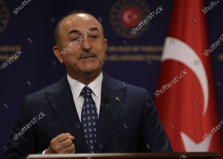 Turkish Foreign Minister Mevlut Cavusoglu speaks during a joint news conference with Sweden's Foreign Minister Ann Linde after their talks, in Ankara, Turkey, . Linde on Tuesday subtly criticized Turkey over its curbs on freedom of expression, after Cavusoglu took a swipe at Stockholm's policies during a joint news conference that quickly turned tense
