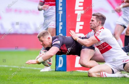 Stock Image of Hull KR's Matt Parcell can't prevent Salford's Luke Yates from scoring a try.