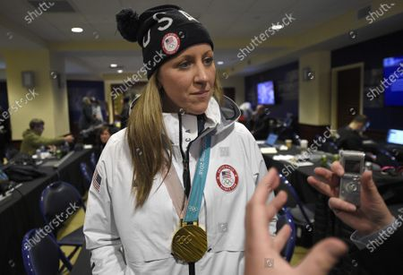 Meghan Duggan, of the gold medal-winning U.S. women's Olympic hockey team, listens to a question from the media before an outdoor NHL hockey game between the Washington Capitals and the Toronto Maple Leafs in Annapolis, Md. U.S. women's hockey captain Duggan announced her retirement, after a career in which she won the 2018 Olympic gold medal and seven world championship golds