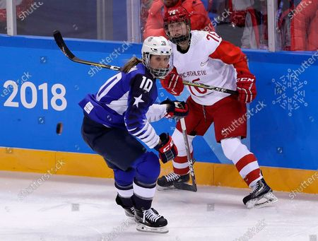 Meghan Duggan (10), of the United States, and Yekaterina Nikolayeva (76), of Russia, chase the puck during the first period of the preliminary round of the women's hockey game at the Winter Olympics in Gangneung, South Korea. U.S. women's hockey captain Duggan announced her retirement, after a career in which she won the 2018 Olympic gold medal and seven world championship golds