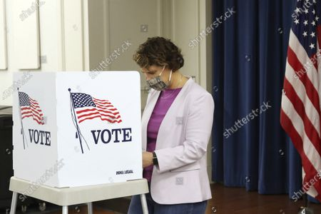 Senate candidate Amy McGrath fills out her ballot at the Scott County Public Library in Georgetown, Ky