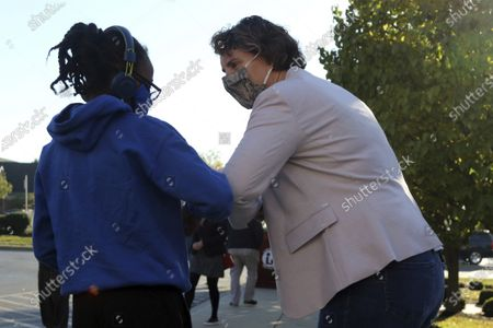Senate candidate Amy McGrath, right, is greeted by a well wisher after voting at the Scott County Public Library in Georgetown, Ky