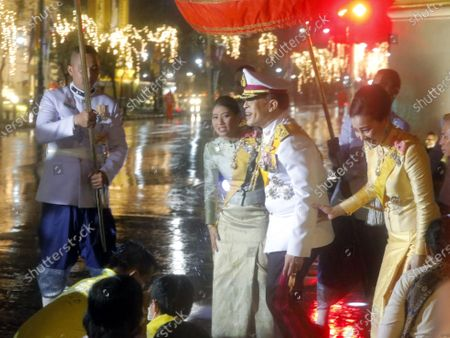 Stock Image of Thai King Maha Vajiralongkorn Bodindradebayavarangkun (C) is accompanied by Thai Queen Suthida (R) and Thai Princess Sirivannavari Nariratana (L) as they appear to greet people after the royal ceremony to commemorate the fourth death anniversary of the late Thai King Bhumibol Adulyadej, outside the Temple of the Emerald Buddha in Bangkok, Thailand, 13 October 2020. King Bhumibol died at the age of 88 on 13 October 2016 after 70 years on the throne.