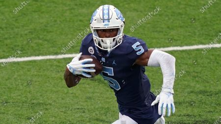 North Carolina wide receiver Dazz Newsome (5) runs the ball during the first half of an NCAA college football game against Virginia Tech in Chapel Hill, N.C