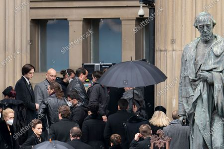 "Filming takes place for the movie ""The Batman"" at St. George's Hall in Liverpool's city center, England, . The production had a break in filming after the star of the movie Robert Pattinson reportedly testing positive for the virus last month"