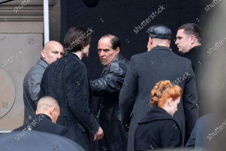 "Colin Farrell, centre, who plays the Penguin, is seen alongside star Robert Pattinson, second left, during filming of ""The Batman"" at St. George's Hall in Liverpool's city center, England, . The production had a break in filming after the star of the movie Robert Pattinson reportedly testing positive for the virus last month"