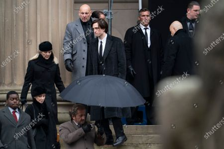 "Stock Photo of Robert Pattinson, center, is seen on the set of the movie ""The Batman"" at St. George's Hall in Liverpool's city center, England, . The production had a break in filming after the star of the movie Robert Pattinson reportedly testing positive for the virus last month"