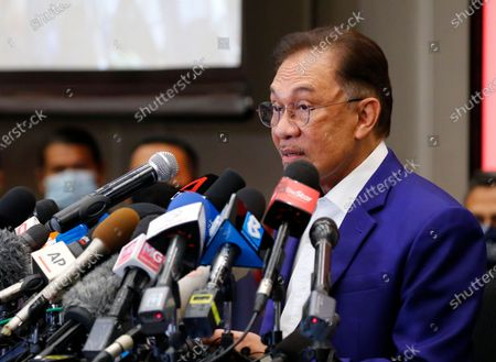 Malaysian opposition leader Anwar Ibrahim speaks during a press conference after meeting the nation's king in Kuala Lumpur. Anwar met the king in a bid to form a new government after claiming he had secured a majority in Parliament.