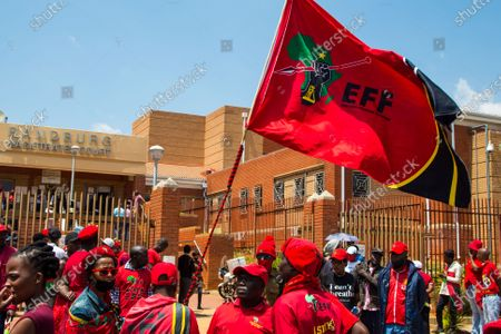 Julius Malema supporters are seen outside Randburg magistrates court waving the Economic Freedom Fighters (EFF) flag. Economic Freedom Fighters (EFF) leader Julius Malema and the party's MP Mbuyiseni Ndlozi appeared in court to answer to allegations that they assaulted a police colonel at struggle icon Winnie-Madikizela-Mandela's funeral in 2018.