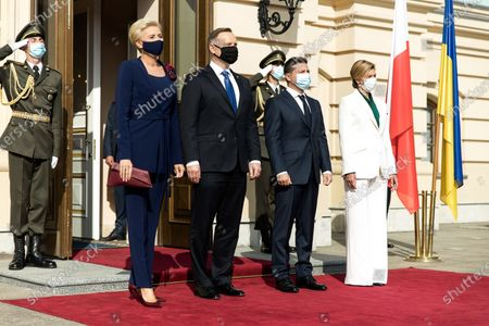 Ukrainian President Volodymyr Zelensky (2nd R) and his wife Olena (1st R) welcome the visiting President of Poland Andrzej Duda (2nd L, front) and his wife Agata Kornhauser-Duda in front of the Mariyinsky Palace in Kiev, Ukraine, Oct. 12, 2020. Ukraine and Poland intend to cooperate to further deepen Ukraine's relations with the European Union and boost bilateral economic cooperation, the two countries' presidents said following their meeting in Kiev on Monday.