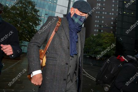 John Leslie leaves Southwark Crown Court on day two of his trial for sexual assault following an alleged incident in a nightclub in 2008.