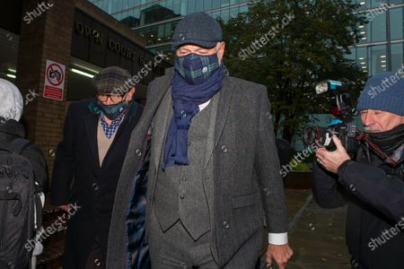 John Leslie leaves Southwark Crown Court on day two of his trial for sexual assault following an alleged incident in a nightclub in 2008. He was accompanied by his father Les Stott (left).