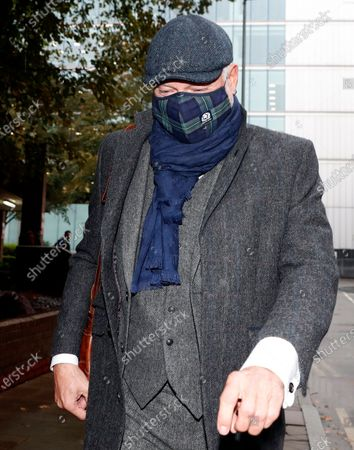 John Leslie, former children's television presenter, leaves Southwark Crown Court on the second day of his trial in London, . Leslie is accused of one count of sexual assault relating to unwanted sexual touching of a woman in 2008
