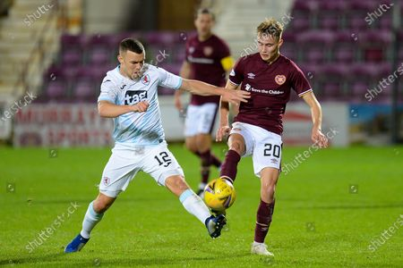 Ross Matthews (#12) of Raith Rovers FC tackles Harry Cochrane (#20) of Heart of Midlothian FC during the Betfred Scottish League Cup match between Heart of Midlothian and Raith Rovers at Tynecastle Park, Edinburgh
