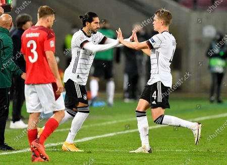 Stock Picture of Germany's Emre Can replaces teammate Matthias Ginter, right, during the UEFA Nations League soccer match between Germany and Switzerland in Cologne, Germany