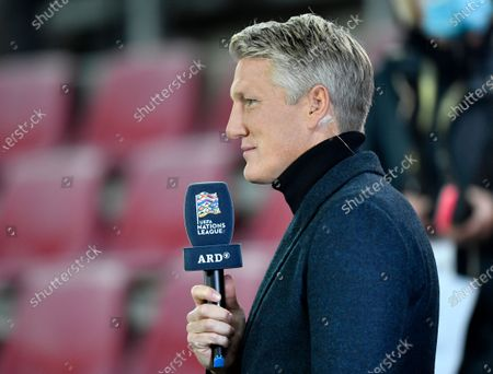 Stock Photo of Former German soccer player Bastian Schweinsteiger conducts an interview ahead of the UEFA Nations League soccer match between Germany and Switzerland in Cologne, Germany