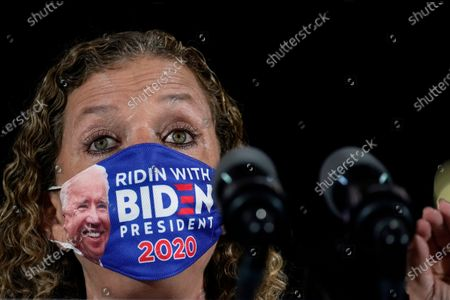 "Wearing a ""Ridin With Biden President 2020"" face mask, Rep. Debbie Wasserman Schultz, D-Fla., speaks before Democratic presidential candidate former Vice President Joe Biden arrives at Southwest Focal Point Community Center in, Pembroke Pines, Fla"
