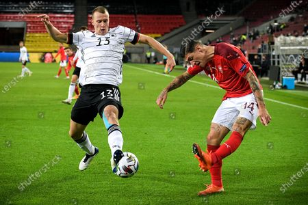 Germany's Lukas Klostermann (L) in action against Switzerland's Steven Zuber (R) during the UEFA Nations League group stage, league A, group 4 soccer match  between Germany and Switzerland in Cologne, Germany, 13 October 2020.