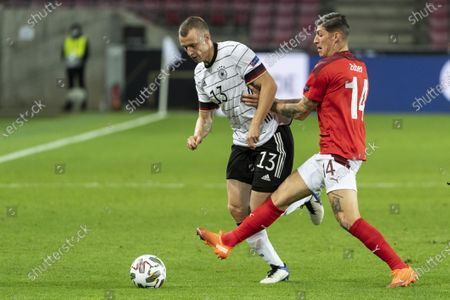 Germany's Lukas Klostermann (L) fights for the ball against Switzerland's Steven Zuber during the UEFA Nations League group stage, League A, group 4 soccer match between Germany and Switzerland in Cologne, Germany, 13 October 2020.