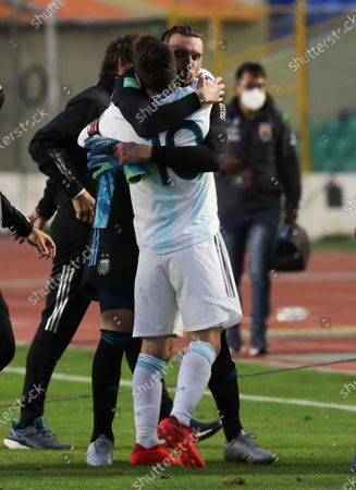 Stock Image of Argentina's goalkeeper Franco Armani, right, embraces teammate Lionel Messi at the end of a qualifying soccer match against Bolivia for the FIFA World Cup Qatar 2022 in La Paz, Bolivia, . Argentina won 2-1