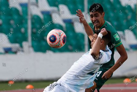 Bolivia's Raul Castro, right, and Argentina's Exequiel Palacios battle for the ball during a qualifying soccer match for the FIFA World Cup Qatar 2022 in La Paz, Bolivia