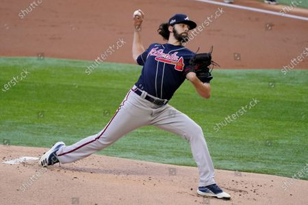 Atlanta Braves starting pitcher Ian Anderson throws against the Los Angeles Dodgers during the first inning in Game 2 of a baseball National League Championship Series, in Arlington, Texas