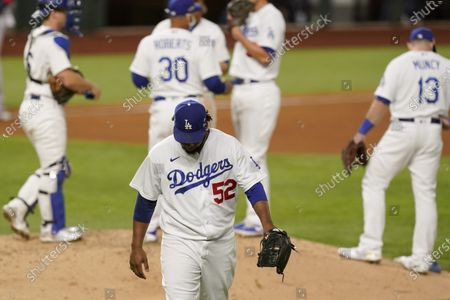 Los Angeles Dodgers relief pitcher Pedro Baez leaves the game against the Atlanta Braves during the fifth inning in Game 2 of a baseball National League Championship Series, in Arlington, Texas