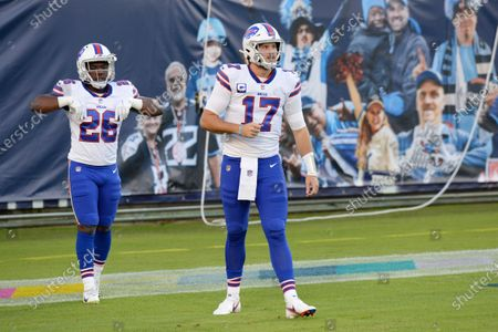 Buffalo Bills quarterback Josh Allen (17) and running back Devin Singletary (26) warm up before an NFL football game against the Tennessee Titans, in Nashville, Tenn