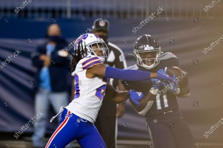 Tennessee Titans wide receiver A.J. Brown (11) makes a touchdown reception against Buffalo Bills cornerback Josh Norman (29) during the first quarter of an NFL football game, in Nashville, Tenn