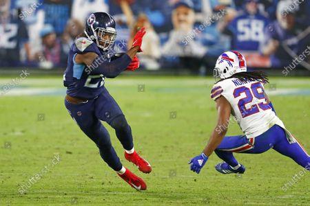 Tennessee Titans running back Derrick Henry (22) carries the ball against Buffalo Bills cornerback Josh Norman (29) in the second half of an NFL football game, in Nashville, Tenn