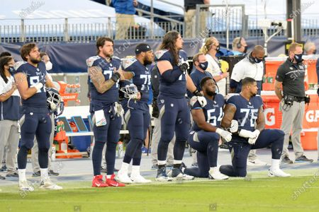 Tennessee Titans offensive guards Nate Davis (64) and Rodger Saffold (76) kneel during the national anthem before an NFL football game against the Buffalo Bills, in Nashville, Tenn