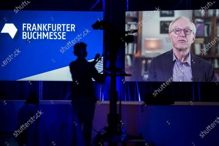 Stock Picture of Israeli writer David Grossman appears on a screen as he delivers a video message at the opening of the 2020 Frankfurt Book Fair amid the coronavirus pandemic in Frankfurt am Main, Germany, 13 October 2020. The Frankfurt Book Fair is the world's largest trade fair for books and is taking place this year at a smaller scale and with many events either online or scattered throughout the city of Frankfurt due to the pandemic. Canada is this year's guest country.