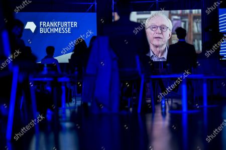 Stock Photo of Israeli writer David Grossman appears on a screen as he delivers a video message at the opening of the 2020 Frankfurt Book Fair amid the coronavirus pandemic in Frankfurt am Main, Germany, 13 October 2020. The Frankfurt Book Fair is the world's largest trade fair for books and is taking place this year at a smaller scale and with many events either online or scattered throughout the city of Frankfurt due to the pandemic. Canada is this year's guest country.