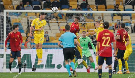 Stock Photo of Pau Torres (L) of Spain, Ukraine's goalkeeper Georgiy Bushchan (5R) and Roman Yaremchuk (2L) of Ukraine in action during the UEFA Nations League group stage, league A, group 4 soccer match between Ukraine and Spain in Kiev, Ukraine, 13 October 2020.