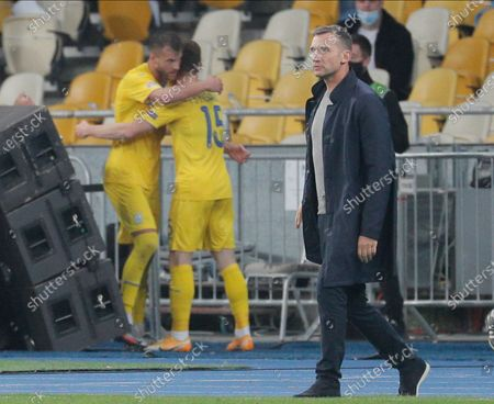 Head coach Andriy Shevchenko (R) of Ukraine walks as Viktor Tsygankov (C) celebrates scoring the 1-0 goal during the UEFA Nations League group stage, league A, group 4 soccer match between Ukraine and Spain in Kiev, Ukraine, 13 October 2020.