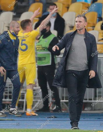 Head coach Andriy Shevchenko (R) of Ukraine walks as Viktor Tsygankov (2-L) celebrates scoring the 1-0 goal during the UEFA Nations League group stage, league A, group 4 soccer match between Ukraine and Spain in Kiev, Ukraine, 13 October 2020.