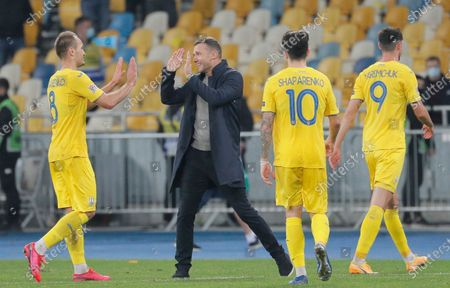 Head coach Andriy Shevchenko (C) of Ukraine celebrates his team's victory with Yevhen Makarenko (L) after the UEFA Nations League group stage, league A, group 4 soccer match between Ukraine and Spain in Kiev, Ukraine, 13 October 2020.