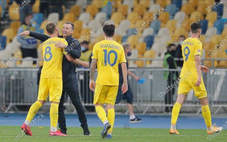 Head coach Andriy Shevchenko (2-L) of Ukraine celebrates his team's victory with Yevhen Makarenko (L) after the UEFA Nations League group stage, league A, group 4 soccer match between Ukraine and Spain in Kiev, Ukraine, 13 October 2020.