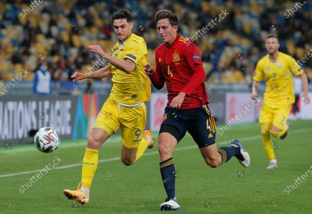 Stock Image of Pau Torres (R) of Spain and Roman Yaremchuk (L) of Ukraine in action during the UEFA Nations League group stage, league A, group 4 soccer match between Ukraine and Spain in Kiev, Ukraine, 13 October 2020.