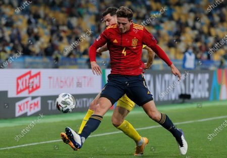 Pau Torres (front) of Spain and Roman Yaremchuk (back) of Ukraine in action during the UEFA Nations League group stage, league A, group 4 soccer match between Ukraine and Spain in Kiev, Ukraine, 13 October 2020.