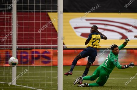 Ecuador's Moises Caicedo scores his side's opening goal against Uruguay's goalkeeper Martin Campana during a qualifying soccer match for the FIFA World Cup Qatar 2022 at the Casa Blanca stadium in Quito, Ecuador