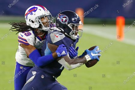 Tennessee Titans wide receiver A.J. Brown (11) is stopped by Buffalo Bills cornerback Josh Norman (29) in the second half of an NFL football game, in Nashville, Tenn