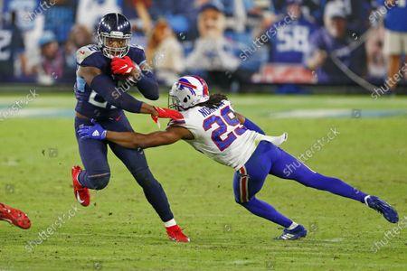 Tennessee Titans running back Derrick Henry (22) gets past Buffalo Bills cornerback Josh Norman (29) in the second half of an NFL football game, in Nashville, Tenn