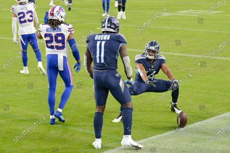 Tennessee Titans wide receiver A.J. Brown (11) celebrates with wide receiver Kalif Raymond (14) after Brown caught a touchdown pass against the Buffalo Bills in the first half of an NFL football game, in Nashville, Tenn. Defending against Brown was Bills cornerback Josh Norman (29