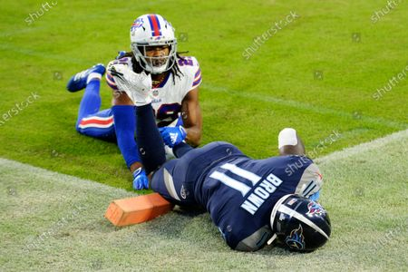 Tennessee Titans wide receiver A.J. Brown (11) hangs onto the ball after catching a touchdown pass as he was defended by Buffalo Bills cornerback Josh Norman (29) in the first half of an NFL football game, in Nashville, Tenn