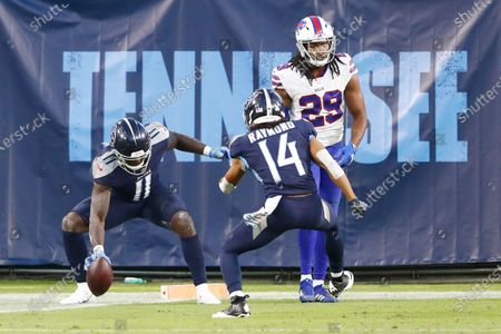 Tennessee Titans wide receiver A.J. Brown (11) celebrates with wide receiver Kalif Raymond (14) after Brown caught a touchdown pass against the Buffalo Bills in the first half of an NFL football game, in Nashville, Tenn. At right is Bills cornerback Josh Norman (29