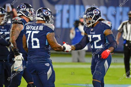 Tennessee Titans running back Derrick Henry (22) is congratulated by offensive guard Rodger Saffold (76) after scoring a touchdown against the Buffalo Bills in the first half of an NFL football game, in Nashville, Tenn