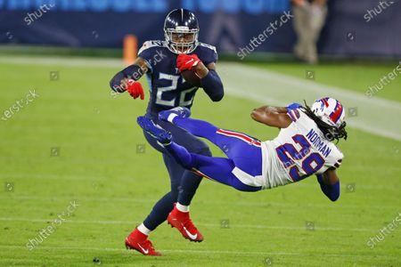 Tennessee Titans running back Derrick Henry (22) knocks down Buffalo Bills cornerback Josh Norman (29) in the first half of an NFL football game, in Nashville, Tenn