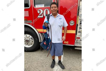 This photo provided by the Los Angeles County Sheriff's Office shows U.S. Postal Service mailman Fernando Garcia. While on his route in Southern California, Garcia came to the rescue of a man who accidentally cut his own arm with a chainsaw late last week, authorities said. Garcia said he found a man with a cut to the arm and used his belt as a tourniquet. He stayed with the man until an ambulance arrived