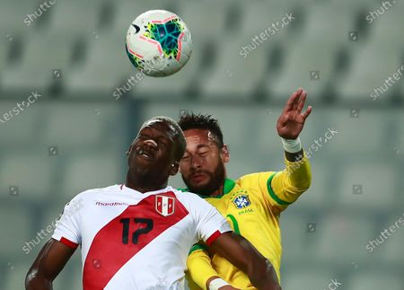Stock Picture of Peru's Luis Advincula, left, and Brazil's Neymar head for the ball during a qualifying soccer match for the FIFA World Cup Qatar 2022 at the National Stadium, in Lima, Peru, Tuesday, Oct.13, 2020